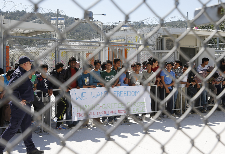Refugees wait to see Pope Francis at the Moria refugee camp on the island of Lesbos, Greece, in this April 16, 2016, file photo. (CNS photo/Paul Haring)