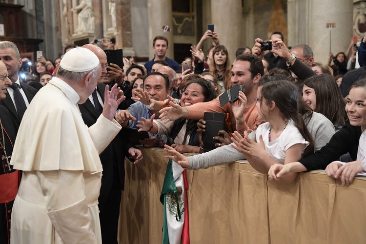 Pope Francis waves during an evening prayer vigil with young people at the Basilica of St. Mary Major in Rome on April 8. (CNS photo/L'Osservatore Romano)