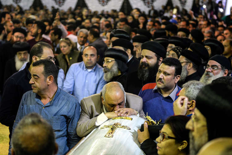 Mourners attend the April 10 funeral for victims of a bomb attack the previous day at the Orthodox Church of St. George in Tanta, Egypt. (CNS photo/Mohamed Hossam, EPA)