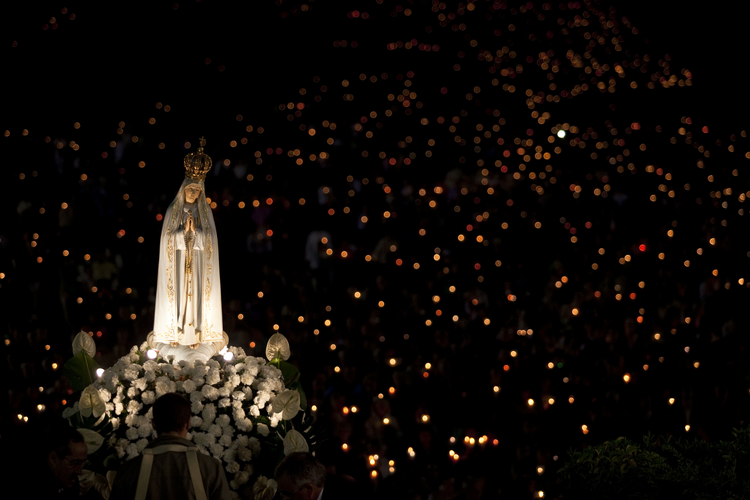 A statue of Mary is carried through the crowd in 2013 at the Marian shrine of Fatima in central Portugal. (CNS photo/Paulo Cunha, EPA)