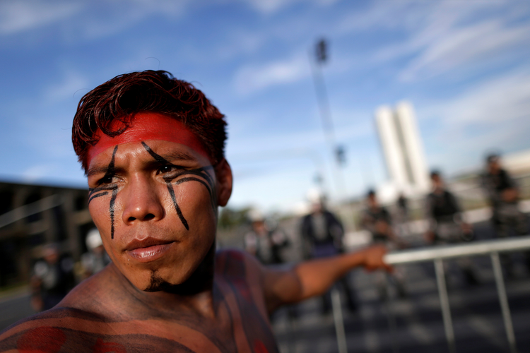 A Brazilian Indian in Brasilia takes part in a demonstration against the violation of indigenous rights on April 27. The Brazilian bishops' Indigenous Missionary Council criticized an April 30 attack in a remote area of Maranhao state that left 13 Gamela Indians injured. (CNS photo/Ueslei Marcelino, Reuters)