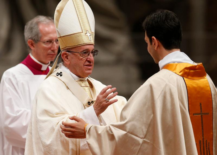 Pope Francis ordains one of 10 new priests for the Diocese of Rome during an ordination Mass in St. Peter's Basilica at the Vatican on May 7. (CNS photo/Paul Haring)