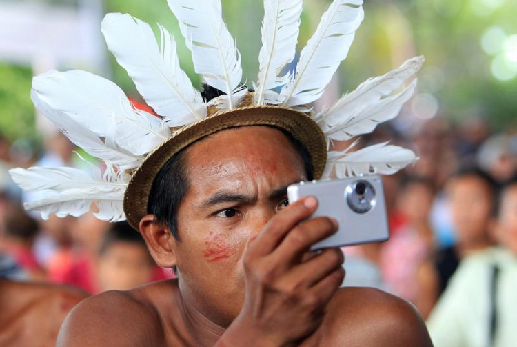 An indigenous member of the Desano ethnic group handles a camera during a meeting in Mitu, Colombia, on Aug. 19, 2016.  (CNS photo/Mauricio Duenas Castaneda, EPA)