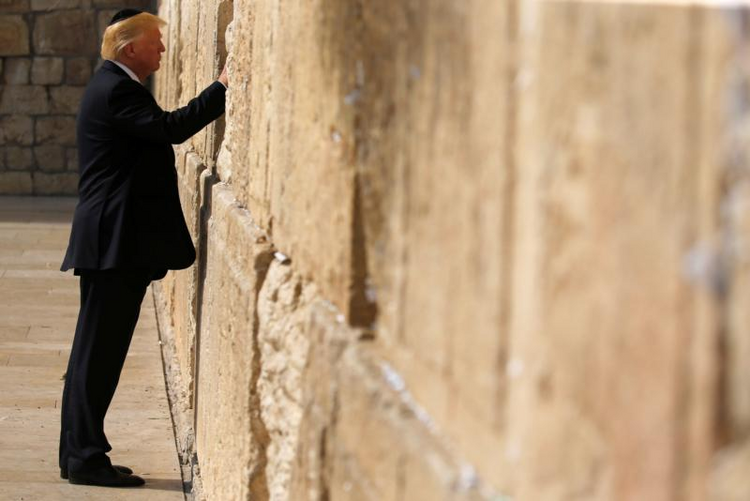 U.S. President Donald Trump places a note in the Western Wall in Jerusalem on May 22. (CNS photo/Jonathan Ernst, Reuters)
