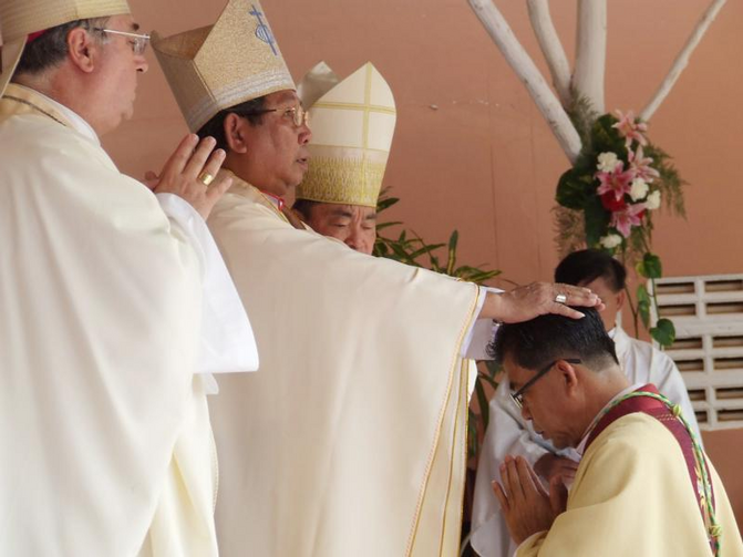 Cardinal-designate Louis-Marie Ling Mangkhanekhoun, apostolic vicar of Pakse, Laos, places his hands on a new bishop during a 2010 ordination Mass. (CNS CNS photo/UCAN handout via EPA)