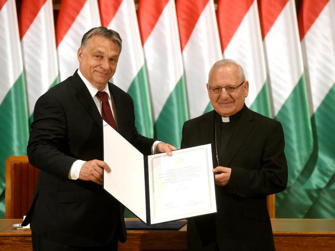Image: Hungarian Prime Minister Viktor Orban and Chaldean Patriarch Louis Sako of Baghdad, Iraq, show the signed agreement on the Hungarian government's contribution of funds for restoring the houses of Iraqi. (CNS photo/Noemi Bruzak, EPA)