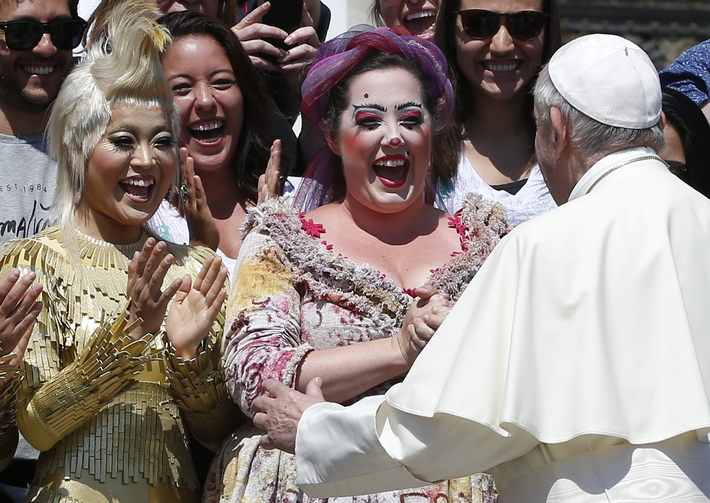 Pope Francis greets artists from Cirque du Soleil during his general audience in St. Peter's Square at the Vatican May 31. (CNS photo/Paul Haring)