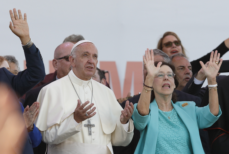 Pope Francis and Patti Gallagher Mansfield, a participant in the 1967 Pittsburgh retreat that marked the beginning of the Charismatic renewal, pray during a Pentecost vigil marking the 50th anniversary of the Catholic charismatic renewal at the Circus Maximus in Rome on June 3. (CNS photo/Paul Haring)