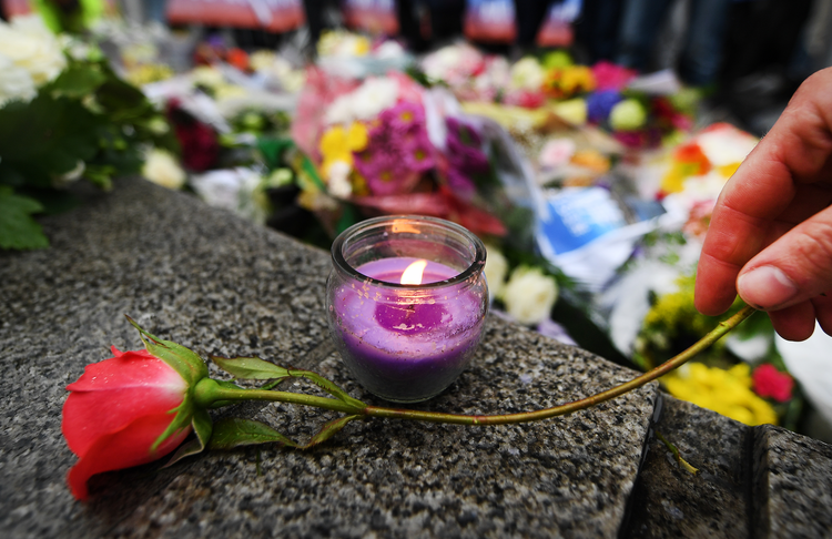 A floral tribute is seen during a vigil outside City Hall in London on June 5. (CNS photo/Andy Rain, EPA)
