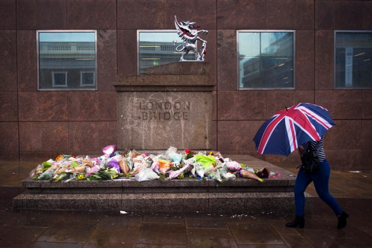 A person walks past a memorial for victims of the London Bridge terror attacks in London, on June 6. Archbishop Peter Smith of Southwark, the archdiocese that covers London south of the River Thames, offered prayers for the victims, survivors and first responders. (CNS photo/Will Oliver, EPA)