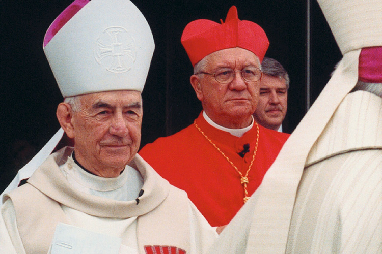 Retired San Francisco Archbishop John R. Quinn, left, is pictured in a 2004 photo in Saginaw, Mich. He died June 22 at age 88 in San Francisco. He headed the Northern California Archdiocese from 1977 until 1995. (CNS photo/Brett McLaughlin, Catholic Weekly)