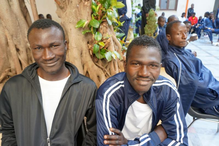 African migrants gather at the Caritas diocesan center in Palmero, Sicily, on June 1. (CNS photo/Dale Gavlak)