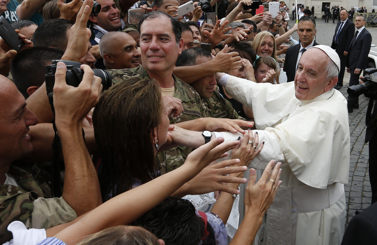 Pope Francis greets the crowd as he leaves his general audience in St. Peter's Square at the Vatican on June 28. (CNS photo/Paul Haring)
