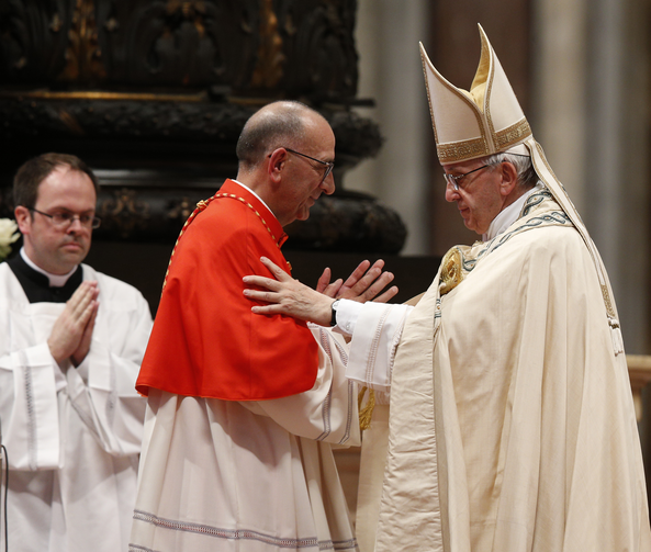 Pope Francis embraces Cardinal Juan Jose Omella of Barcelona, Spain, as the pontiff leads a consistory in St. Peter's Basilica at the Vatican June 28. The Spaniard was one of five men elevated to cardinal at the service. (CNS photo/Paul Haring)