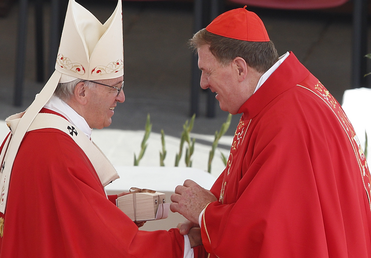 Pope Francis presents a box containing a pallium to Cardinal Joseph W. Tobin of Newark, N.J., at the conclusion of Mass marking the feast of Sts. Peter and Paul in St. Peter's Square at the Vatican on June 29. New archbishops from around the world received their palliums from the pope. The actual imposition of the pallium will take place in the archbishop's archdiocese. (CNS photo/Paul Haring)