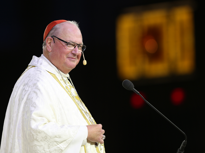 "Cardinal Timothy M. Dolan of New York smiles as he delivers the homily during the opening Mass of the ""Convocation of Catholic Leaders: The Joy of the Gospel in America"" on July 1 in Orlando, Fla. (CNS photo/Bob Roller)"