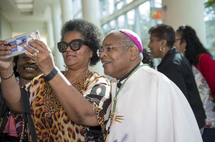 Retired Bishop Gordon D. Bennett of Mandeville, Jamaica, poses for a photo with an attendees of the 12th National Black Catholic Congress on July 9 in Orlando. (CNS/courtesy Nancy Jo Davis, National Black Catholic Congress)
