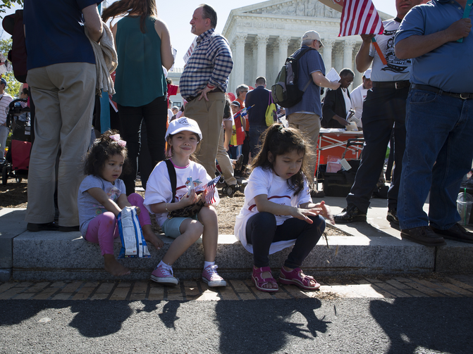 "An immigration rally takes place April 18 outside the U.S. Supreme Court in Washington. The U.S. bishops' migration committee chair in a July 18 statement urged President Donald Trump to ""ensure permanent protection"" for youth under the Deferred Action for Childhood Arrivals program, or DACA. (CNS photo/Tyler Orsburn)"