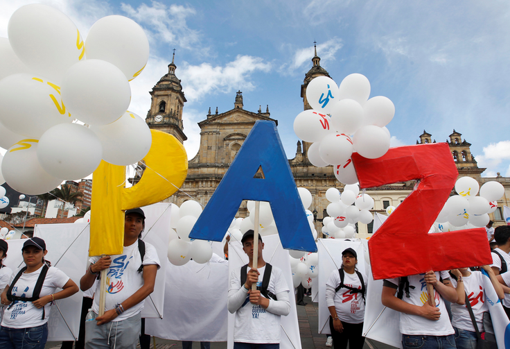 "People form the word ""Peace"" outside the cathedral in Bogota, Colombia, on Sept. 26, 2016. The Colombian government and Marxist rebels signed an agreement that day to end Latin America's last armed conflict. (CNS photo/Felipe Caicedo, Reuters)"