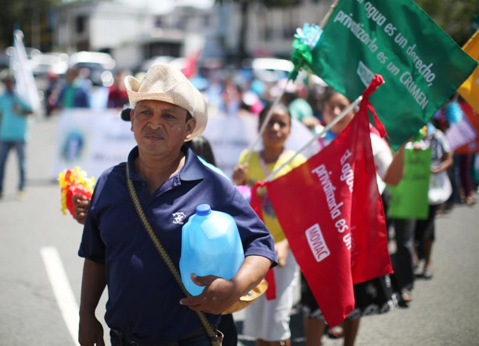 Protesters in San Salvador, El Salvador, demand that lawmakers provide water access to the poor in this July 2017 photo. (CNS photo/Jose Cabezas, Reuters)