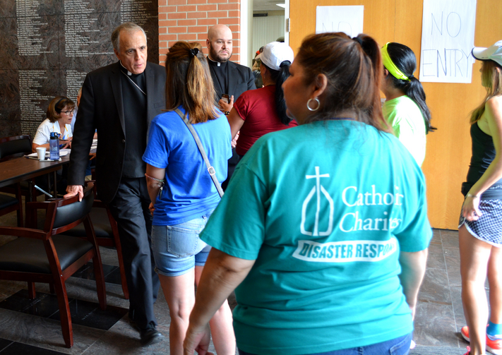 Cardinal Daniel N. DiNardo of Galveston-Houston, president of the U.S. Conference of Catholic Bishops, visits a Catholic Charities center in Houston, Texas, on Sept. 3. (CNS photo/courtesy Catholic Charities)