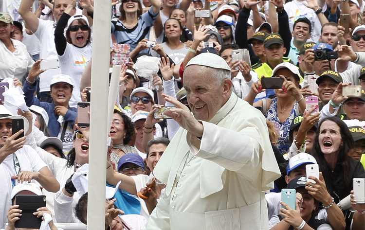 Pope Francis greets the crowd before celebrating Mass at Enrique Olaya Herrera Airport in Medellin, Colombia, Sept. 9. (CNS photo/Paul Haring)