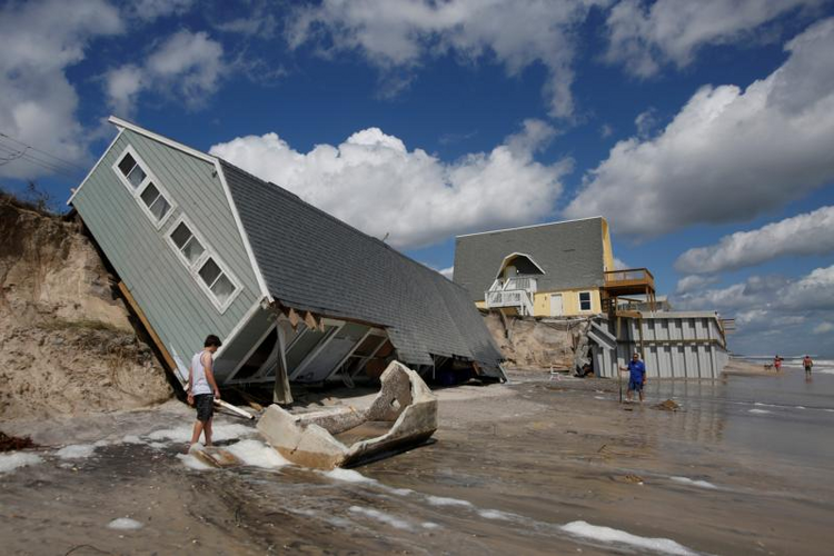 Residents look at a collapsed house on Sept. 12 after Hurricane Irma passed the area in Vilano Beach, Florida. (CNS photo/Chris Wattie, Reuters)