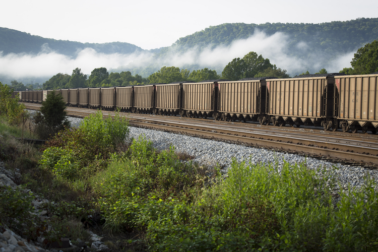 A train carries coal near Ravenna, Ky., in this 2014 file photo. Catholic groups are developing a new tool to rank countries' work in human and environmental development. (CNS photo/Tyler Orsburn)