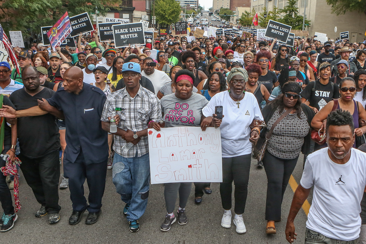 Anthony Lamar Smith's mother, Annie, center, walks with family and protesters during a peaceful rally on Sept. 17 after a not guilty verdict in the murder trial of former St. Louis police officer Jason Stockley, charged with the 2011 fatal shooting of Anthony Lamar Smith, who was black. Stockley is white. (CNS photo/Lawrence Bryant, Reuters)