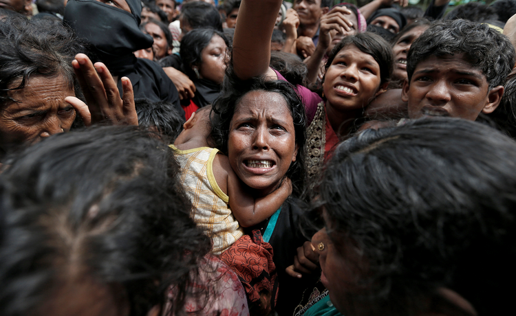 Rohingya refugees wait to receive aid Sept. 21 at a camp in Cox's Bazar, Bangladesh. (CNS photo/Cathal McNaughton, Reuters)
