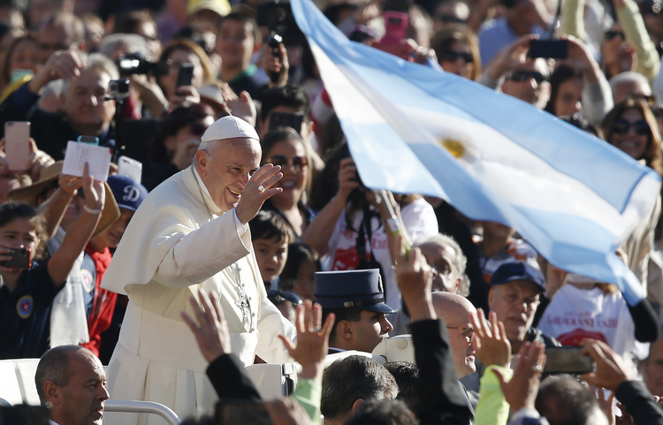 Argentina's flag is seen as Pope Francis greets the crowd during his general audience in St. Peter's Square at the Vatican on Oct. 11. (CNS photo/Paul Haring)