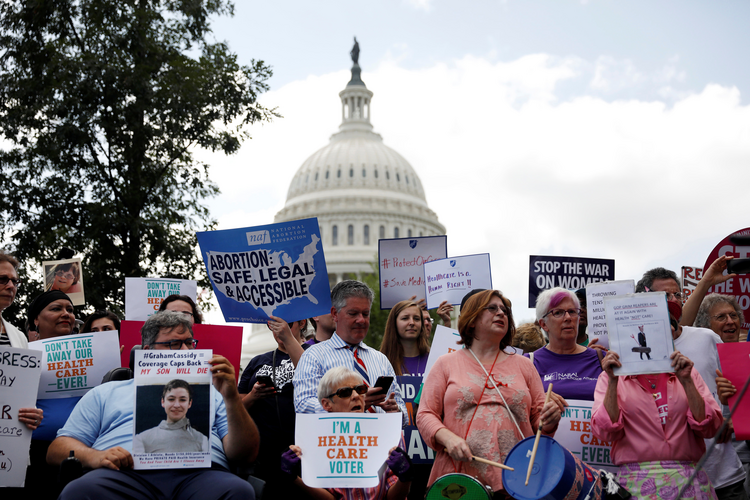 Activists participate in a rally in late September to protect the Affordable Care Act outside the U.S. Capitol in Washington. (CNS photo/Aaron P. Bernstein, Reuters)