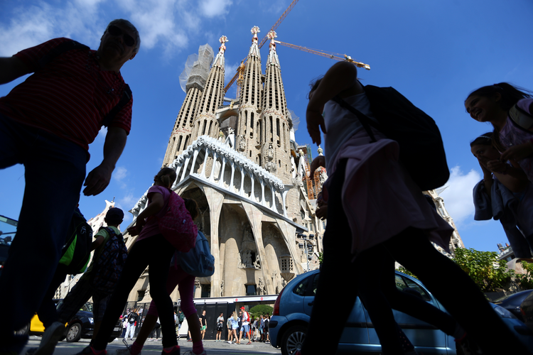 People walk near the Sagrada Familia basilica in Barcelona, Spain, Oct. 11. Ten days later, Cardinal Angelo Amato, prefect of the Vatican's Congregation for Saints' Causes, beatified 109 Spanish Claretian missionaries killed during their country's 1936-39 civil war. (CNS photo/Ivan Alvarado, Reuters)