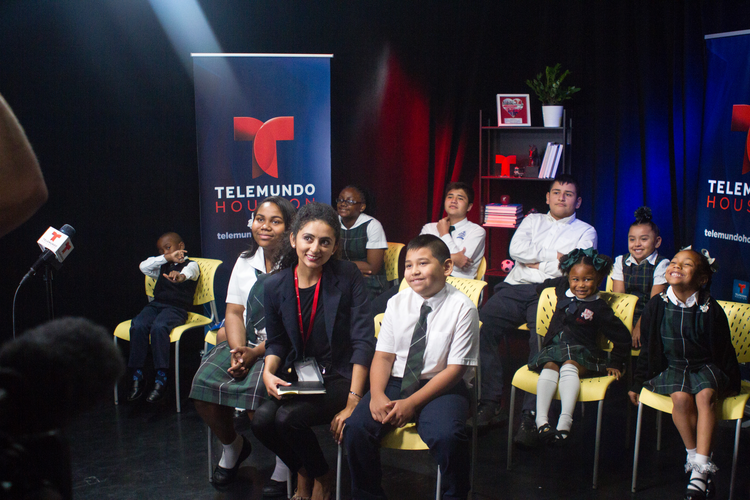 Galveston-Houston Catholic school students smile for a photo before a live video chat with Pope Francis at Telemundo Houston Oct. 26. In a video chat with young children from Texas and Puerto Rico, the pope said there are no easy answers to the suffering and destruction wrought by hurricanes. (CNS photo/James Ramos, Texas Catholic Herald)