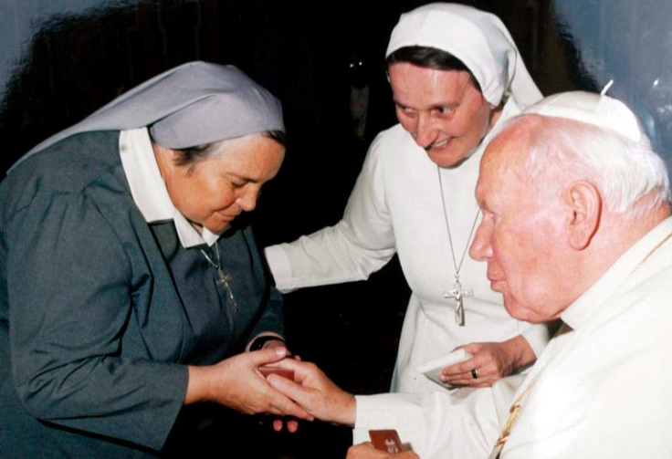 St. John Paul II presents a gift to Consolata Sister Leonella Sgorbati in Milan, Italy, in this undated photo. Sister Leonella and her bodyguard were gunned down in September 2006 as they left the children's hospital where she worked in Mogadishu, Somalia. (CNS photo/PH Emmevi, EPA)