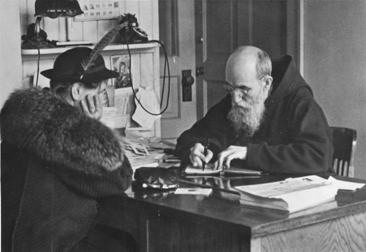 Blessed Solanus Casey, who was beautified during a Mass on Nov. 18 at Ford Field in Detroit, records a note from a woman who visited him at St. Bonaventure Monastery in Detroit in 1941. The Capuchin Franciscan friar kept dozens of notebooks filled with prayer requests and favors from the thousands who visited him each year. (CNS photo/Archdiocese of Detroit)
