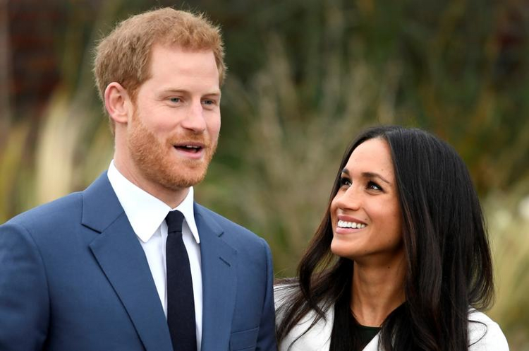 Britain's Prince Harry poses with Meghan Markle on Nov. 27 in the Sunken Garden of Kensington Palace in London after announcing their engagement. Markle attended Immaculate Heart High School in Los Angeles. (CNS photo/Toby Melville, Reuters)