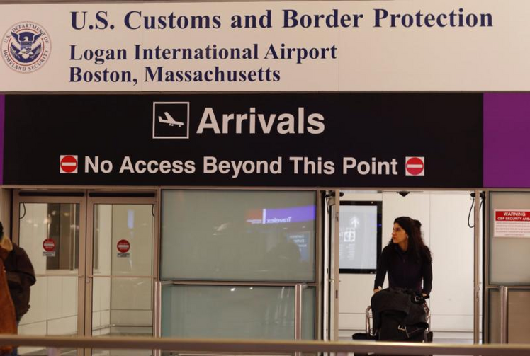 A passenger arrives through the U.S. Customs gate Dec. 4 at Logan International Airport in Boston. The Supreme Court will allow the latest version of President Donald Trump's travel ban to take effect while the legal fight over it winds through the lower courts. (CNS photo/CJ Gunther, EPA)