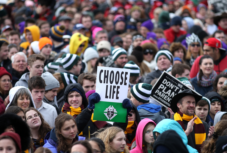 "Pro-life advocates attend the 2017 annual March for Life in Washington Jan. 27. March for Life organizers announced at a Dec. 6 briefing that ""Love saves Lives"" is the theme for the 2018 march planned for Jan. 19. (CNS photo/Tyler Orsburn)"