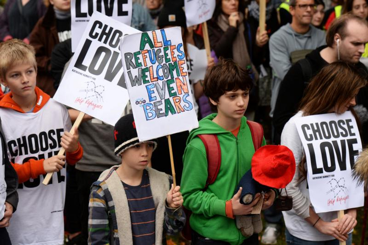 Young demonstrators gather outside Parliament in London on Oct. 24 to call for more child refugees to be allowed asylum and safe passage to the United Kingdom. (CNS photo/Mary Turner, Reuters)