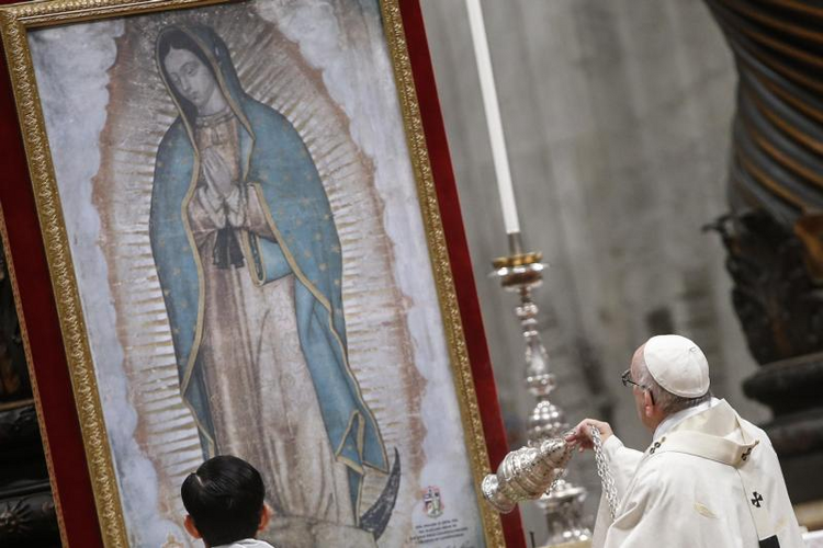 Pope Francis swings a censer in front of an image of Our Lady of Guadalupe as he celebrates Mass on Dec. 12 marking her feast day in St. Peter's Basilica at the Vatican. (CNS photo/Fabio Frustaci, EPA)