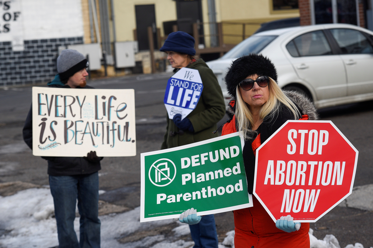 "Pro-life supporters protest in front of a Planned Parenthood center in early February in Philadelphia. Pennsylvania Gov. Tom Wolf vetoed pro-life legislation that ""would have strengthened"" the state's Abortion Control Act ""by banning the cruel and brutal practice of dismemberment abortions,"" said the state Catholic conference. (CNS photo/Charles Mostoller, Reuters"