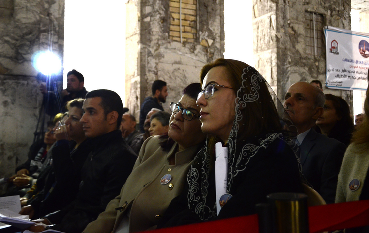 Chaldean Christians in Mosul, Iraq, attend Christmas Mass at St. Paul Cathedral Dec. 24. (CNS photo/Amar Salih, EPA)