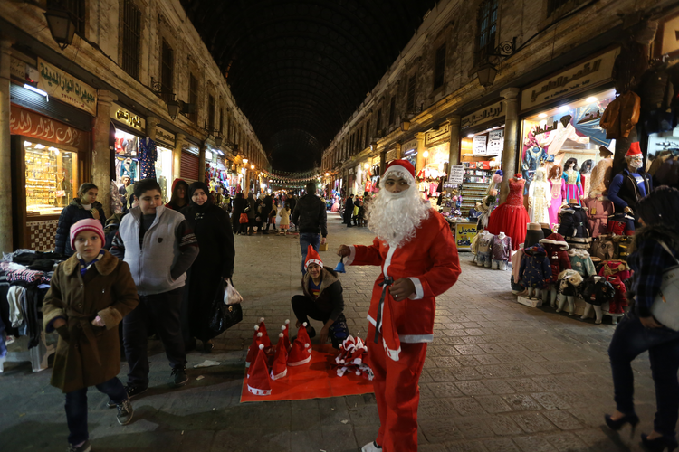 A man dressed as Santa is seen in Damascus, Syria, Dec. 24. Catholic patriarchs of the Middle East called for peace, security, prayer and solidarity at Christmastime.