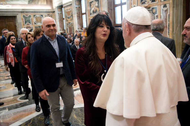 Pope Francis greets members of the Italian Association of Catholic Teachers during a Jan. 5 meeting in Clementine Hall at the Vatican. The group of elementary school teachers recently held its national congress in Rome. (CNS photo/L'Osservatore Romano)