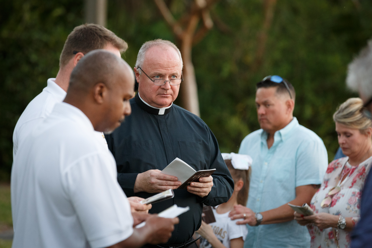 Father Ireneusz Ekiert, administrator of Mary Help of Christians Church in Parkland, Fla., leads parishioners during an outdoor Stations of the Cross service on Feb. 16 dedicated to the victims and survivors of the deadly mass shooting at nearby Marjory Stoneman Douglas High School. (CNS photo/Tom Tracy)