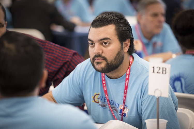 Mark Gomez, a lay leader of Encuentros Juveniles in the Miami Archdiocese, listens during the Encuentro gathering on Feb. 23 in that city. (CNS photo/Tom Tracy)