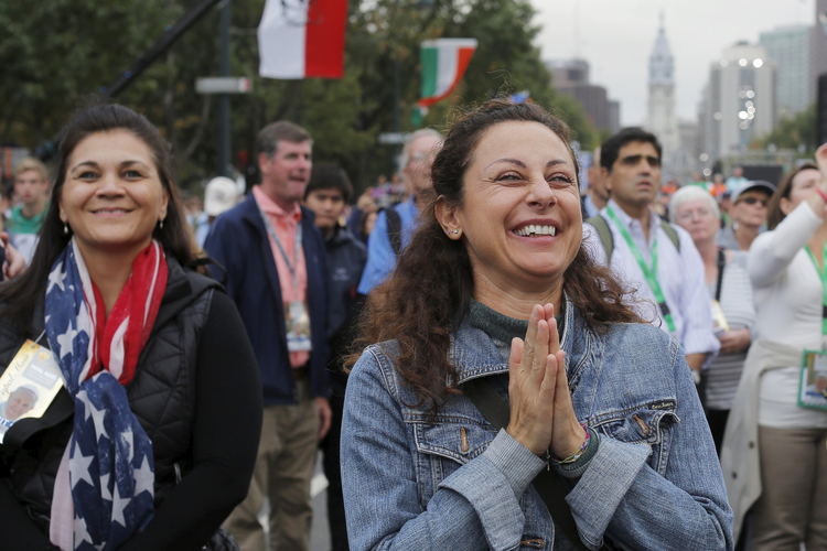 A woman reacts to Pope Francis' final words during the closing Mass of the World Meeting of Families in Philadelphia in this 2015 file photo. The pope will attend the next W.M.F., to be held Aug. 21-26 in Dublin. (CNS photo/Brian Snyder, Reuters)