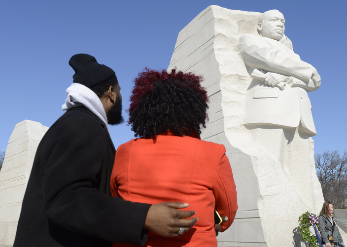 Aaron Brown of Houston and Arielle Phillips of Charlotte, N.C., pause to view a 30-foot sculpture of the Rev. Martin Luther King Jr. in Washington Jan. 19. (CNS photo/Mike Theiler, Reuters)