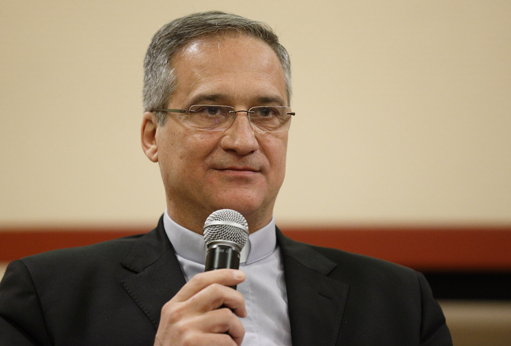 Msgr. Dario Vigano, then-prefect of the Vatican Secretariat for Communication, is pictured at a news conference at the Vatican in this Feb. 8 file photo. (CNS photo/Paul Haring)